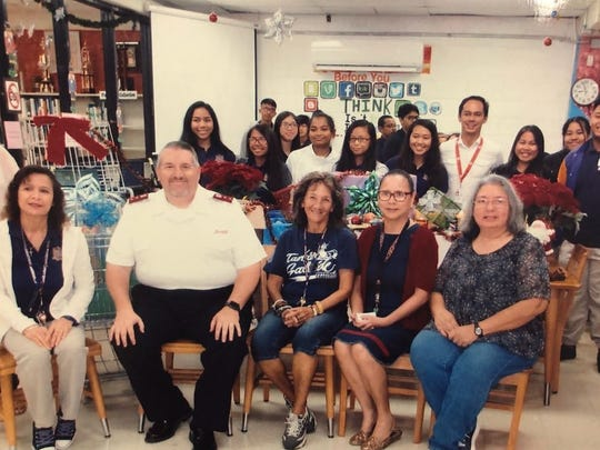 G.W. High School student of Bernice Babauta, Tina Flores and Rose Unpingco donated several boxes of canned food to Salvation Army. Pictured seated from left: Lynda H. Avilla, principal, Capt. Tom, Salvation Army, Tina Flores, Bernice Babauta and Rose Unpingco.