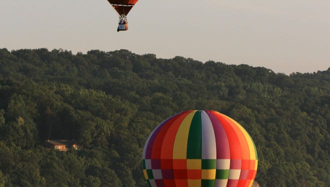 Hot air balloons take off from the banks of the Hudson River in Poughkeepsie during the annual Dutchess County Balloon Festival July 6, 2013.