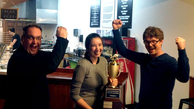 A quick, fun picture of Michael Haskett (right) passing the Food Falls Trophy to Jennifer Kelly of Fiero Pizza. Congrats again to Fiero for the 2015 win, and thanks to Haskett for being an awesome champion this last year.
