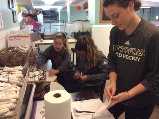 Members of the Rutgers women's field hockey team prepare