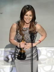 "Kathryn Bigelow accepts the Best Director Oscar for ""The Hurt Locker"" at the 82nd Academy Awards Sunday, March 7, 2010."