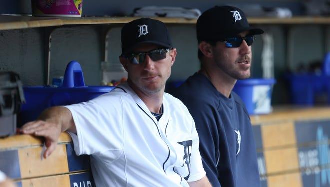 Detroit Tigers pitchers Max Scherzer, left, and Justin Verlander sit in the dugout June 18, 2014, at Comerica Park in Detroit.