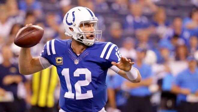 Indianapolis Colts quarterback Andrew Luck (12) looks for a receiver upfield during the first half of an NFL football game Sunday, Sept. 25, 2016, at Lucas Oil Stadium.