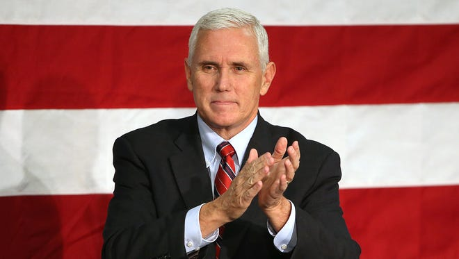 Indiana Gov. Mike Pence, the Republican nominee for vice president, thanks the crowd after speaking at the Allen County War Memorial Coliseum, Fort Wayne, Ind., Friday, Sept. 30, 2016.