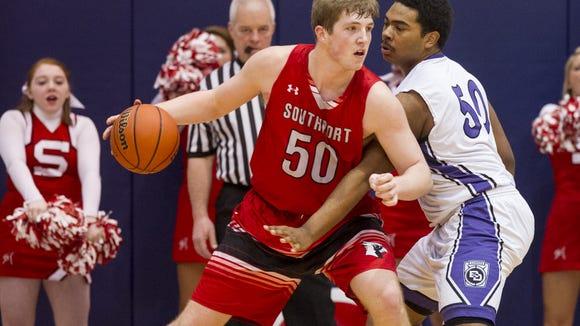 Southport High School junior Joey Brunk (50) tries