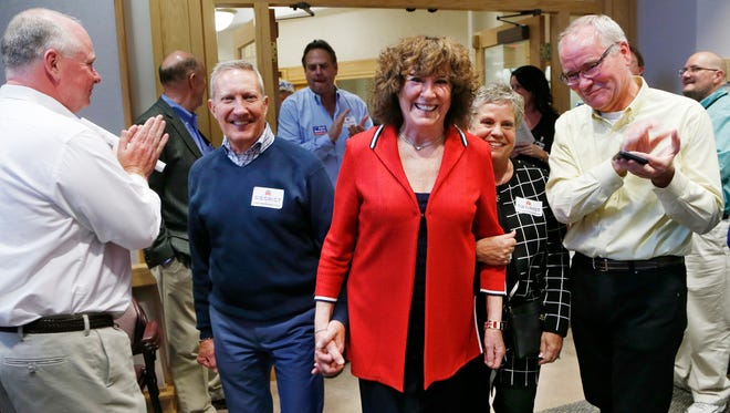 Republican Sally Siegrist, a candidate for the Indiana House District 26 seat,  is applauded by her supporters as she arrives to watch election returns Tuesday, May 3, 2016, at the Tippecanoe County Office Building in downtown Lafayette. Siegrist is joined by her cousin Nena Peplow, right, and her husband, Dick. Siegrist defeated Gerry Keen for the Republican nomination.