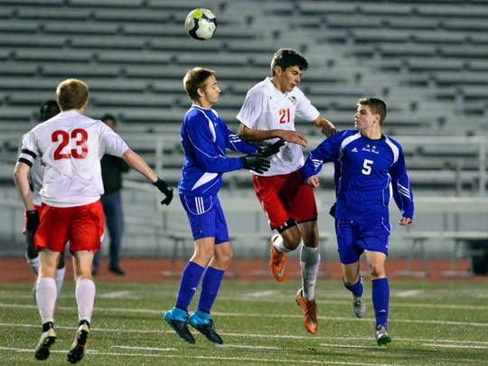 Susquehannock's Kaleb Lippy heads the ball away from