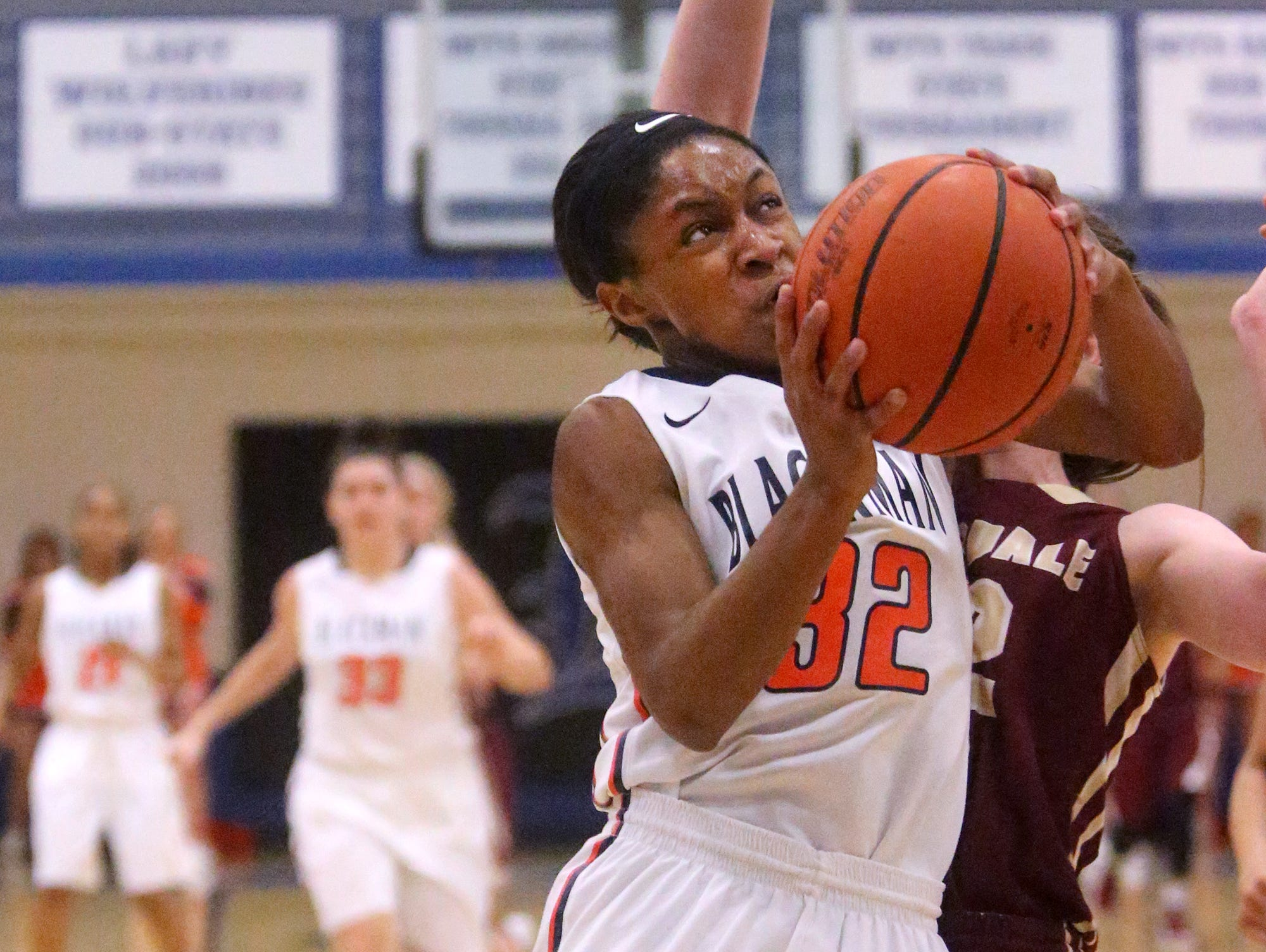 Blackman's Crystal Dangerfield (32) goes for a shot during the Region 4-AAA girls basketball semifinal game against Riverdale, on Monday, Feb. 29, 2016, at La Vergne.