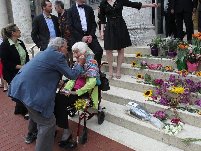 Father Robert Browning greets Berne Davis' sister,