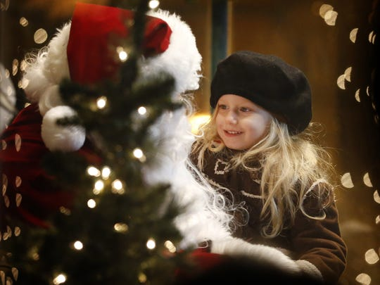 A child tells Santa what she would like for Christmas during last year's Sparkle event in Corning.