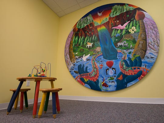 """View of a mural entitled """"Journey Into Healing"""" in the waiting room at the Children's Advocacy Center of Delaware in Dover.  The mural was a collaboration among the national Arts Honor Society and the National Junior Arts Honor Society of Holy Rosary School and the national A.R.T.S. Center along with five survivors from S.O.A.R. (Survivors of Abuse in Recovery), Inc."""