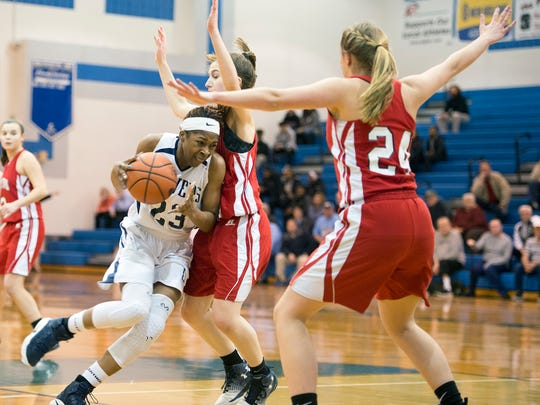 Lebanon Catholic's Alexis Hill (23) drives through