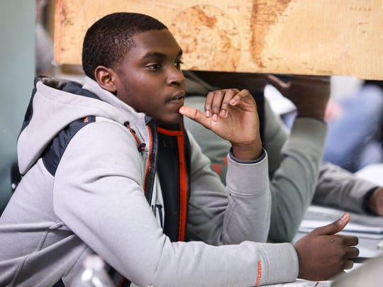 Nasai Oliver, 15, listens during a class in the Launcher Entrepreneurship Training Program at West End Neighborhood House in Wilmington.