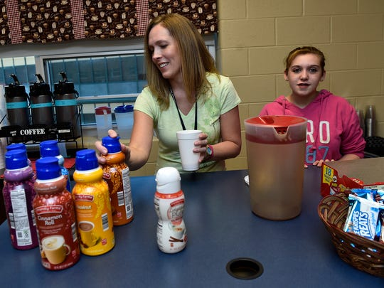 Classroom assistant Alice Laraia, left, and student Kodie Clark prepare drinks for customers on Tuesday, May 9, 2017 at the Life Skills Coffee Shop at Chambersburg Area Senior High School. The student run business raises funds for special projects at CASHS.