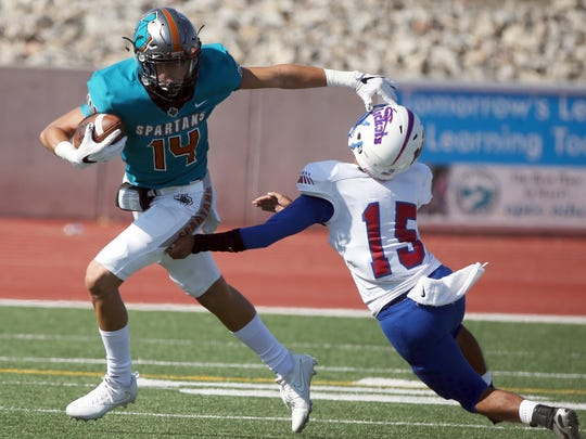 Pebble Hills wide receiver Haredt Gonzalez, 14, gets away from an Irvin defender Thursday at the Socorro Activities Complex.