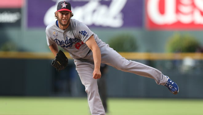 Los Angeles Dodgers starting pitcher Clayton Kershaw works against the Colorado Rockies in the first inning in Denver.