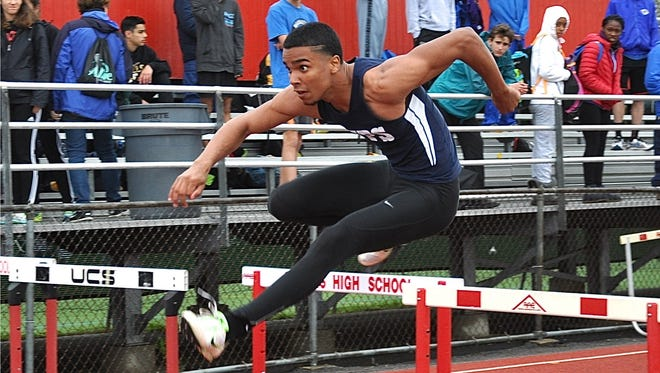 Emilio Wilson-King of Yonkers clears hurdle during the boys shuttle hurdle relay in which Yonkers placed third..