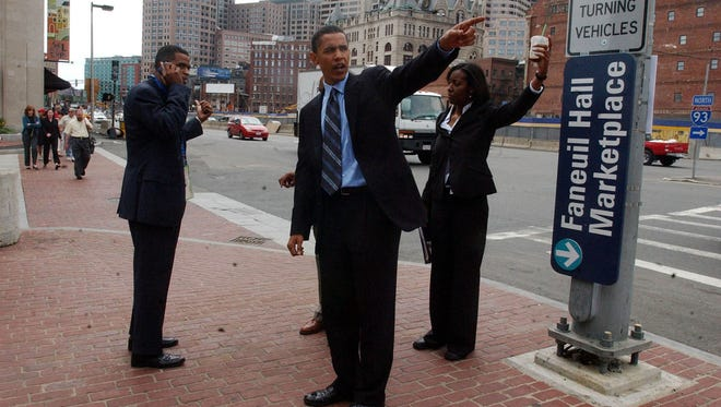 Barack Obama, center, then a candidate for the United States Senate from Illinois, points the way as he and his aides make their way to a League of Conservation Voters rally for John Kerry in Boston on July 27, 2004.