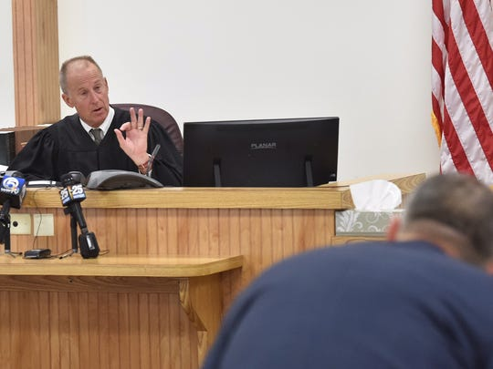 Circuit Judge Dan Vaughn confers with Assistant State Attorney Tom Bakkedahl on Tuesday, Sept. 20, 2016, after the grand jury decision clears Fort Pierce police officers in the fatal shooting of Demarcus Semer.