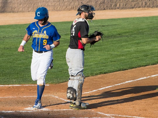 Dan Motl (9) scores a run during an exhibition game
