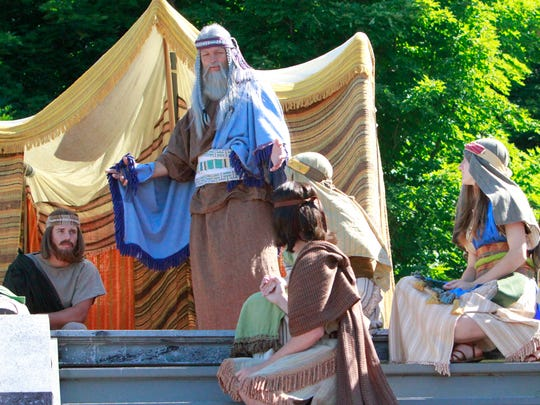 Performers run through a scene during a 2014 dress rehearsal for the Hill Cumorah Pageant in Manchester, Ontario County.