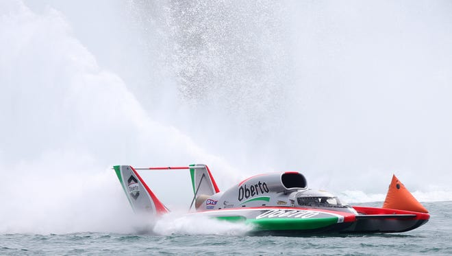 The Oberto boat driven by Jimmy Shane goes through the Rooster Tail turn during qualifying for the Detroit APBA Gold Cup Race on July 12, 2014 in Detroit.