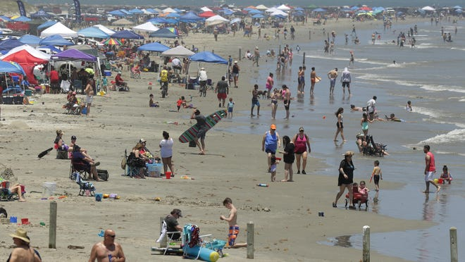 Crowds gather on the beach in Port Aransas during the Memorial Day weekend. The Houston area has seen an increase in COVID-19 cases in recent days, and health officials think it might be because people let their guard down on the holiday weekend and as businesses were allowed to reopen.