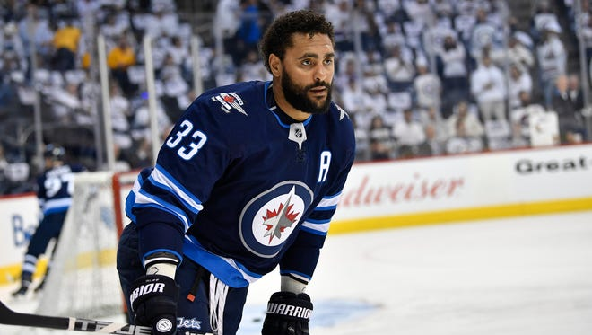 Winnipeg Jets defenseman Dustin Byfuglien (33) warms up before Game 3 against the Nashville Predators in the second-round NHL Stanley Cup playoff series at Bell MTS Place in Winnipeg, Manitoba, Canada, Tuesday, May 1, 2018.