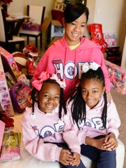 Sheena Page with her daughters Ke'ani, left, and Shania,