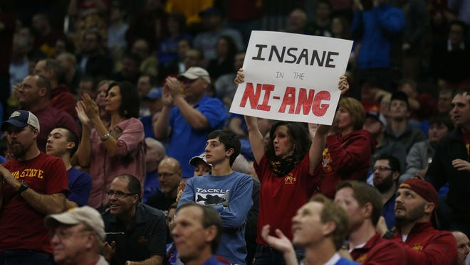 An Iowa State fan holds up a sign in the crowd during the Iowa State vs. Oklahoma Big 12 Tournament game on Thursday, March 10, 2016, at the Sprint Center in Kansas City. The Cyclones fell to the Sooners 79-76.