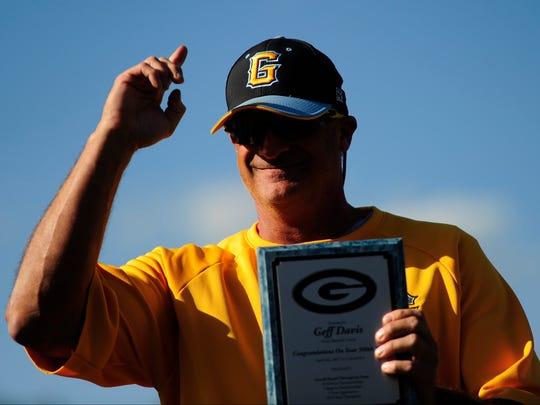 Gibbs Head Coach Geff Davis is awarded a plaque commemorating