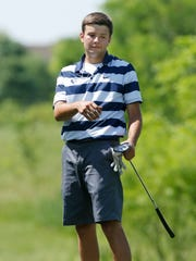 Central Catholic's Colin McNeely watches his putt at