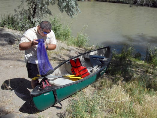 Brad Larkin with Nevada Parks prepares a canoe for a trip down the Carson River Wedneday June 18, 2014.