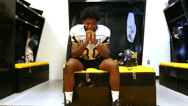 Parkland running back Deion Hankins pauses in the locker room prior to Wednesday's practice.