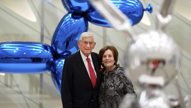 "FILE - In this Sept. 16, 2015 file photo, Eli Broad and his wife, Edythe, stand for a photo amid Jeff Koons sculptures at his new museum called ""The Broad"" in downtown Los Angeles. Eli Broad, a charter school advocate has contributed at least $3.7 million since 2007 to political efforts to expand charter schools. (AP Photo/Richard Vogel,file)"