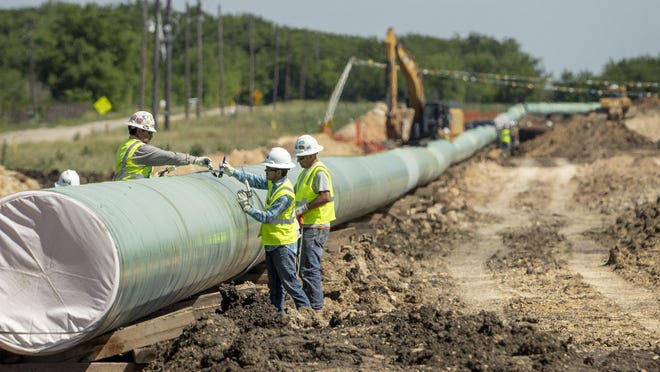 The City of Kyle received more than $1.3 million on Tuesday, as part of a $2.7 million settlement that will allow Kinder Morgan to construct the Permian Highway Pipeline through the city.