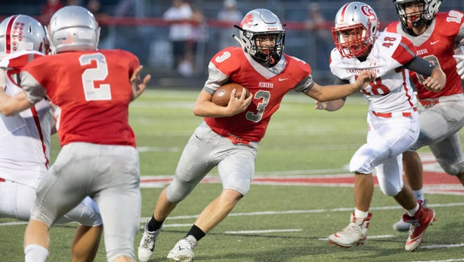 Brayden Costea of Minerva looks for running room against Canton South in 2019.