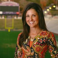 Kathleen Swinney can often be found cheering from the sidelines as her husband, Dabo Swinney, coaches the Clemson University football team, but she's also a devoted mom.