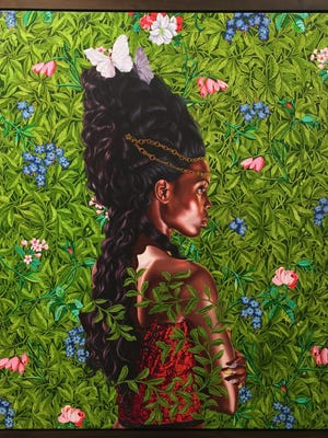 """Kehinde Wiley's """"Portrait of Bintou Fall"""" (oil on linen) is part of 21c Museum Hotel's exhibit """"Pop Stars! Popular Culture and Contemporary Art."""""""