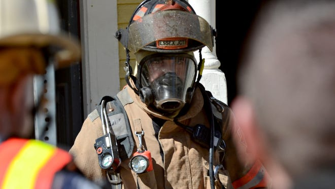 A firefighter emerges from an duplex at 35 Platt St. in Winooski after battling a blaze Friday afternoon, May 12, 2017, that left the residence uninhabitable.