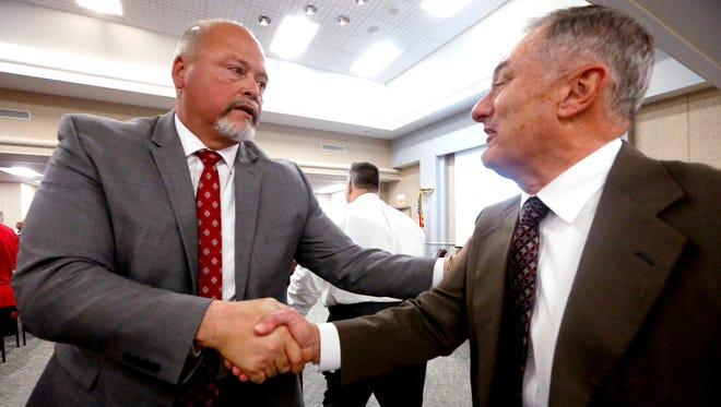 Oakland High School Principal Bill Spurlock, is congratulated by many of his supporters after the Rutherford County School board offers the Directors job to Spurlock on Wednesday, April 4, 2018, at the Rutherford County School Board Office.