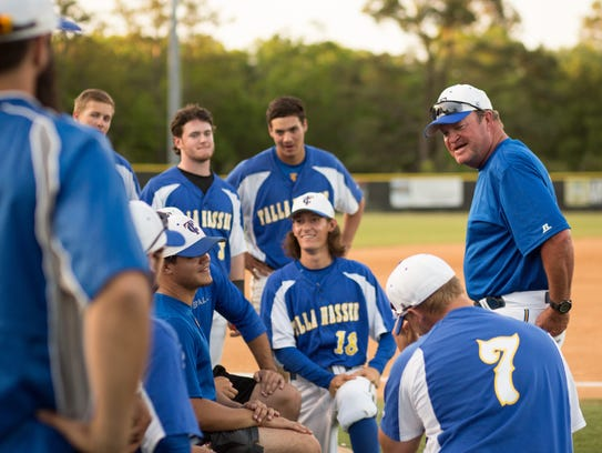 Coach Mike McLeod talking to his team after a victory