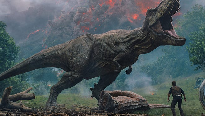 "Owen (Chris Pratt) comes between the mighty T. rex in ""Jurassic World: Fallen Kingdom"" and Claire (Bryce Dallas Howard). But dinosaurs are proving hard to contain in the second ""Jurassic World"" film."