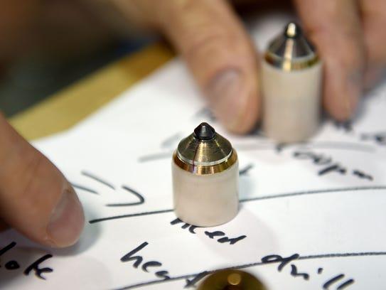 Reinhard Boehler, a scientist at ORNL, holds a 10 carat