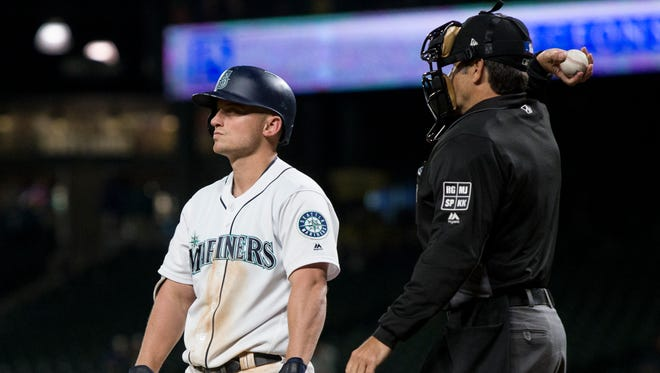 Seattle Mariners' Kyle Seager reacts after striking out in the ninth inning of Tuesday's game.