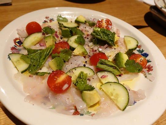 Ceviche de pescado with cucumber, tomato, avocado,