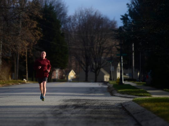 Chris Doemland goes for a run near his in-laws' house in Springettsbury Township. Doemland tries to balance training and family life by doing most of his workouts early in the morning or late at night.