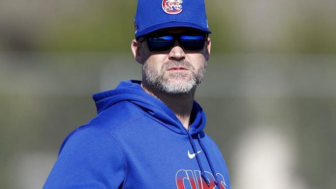 Chicago Cubs manager David Ross watches during a spring training baseball workout in Mesa, Arizona earlier this year.