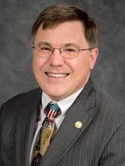 Dr. John R. Vile is a professor of political science
