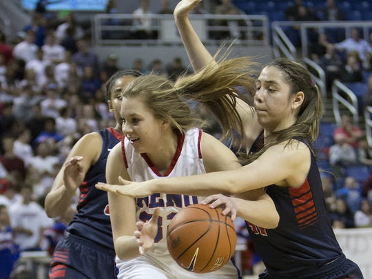 Reno's Morgan McGwire drives against Liberty in their Division I State Championship basketball game at Lawlor Event Center in Reno, Nevada on Feb. 28, 2014.